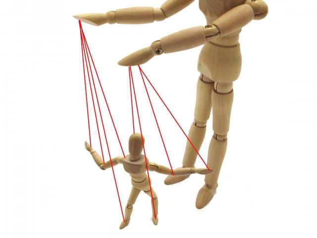 人を動かす操り人形